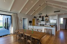Clutha River House Chris Norman Architecture » Archipro Timber Pergola, Timber Shelves, Cedar Cladding, Stone Chimney, White Subway Tiles, Light And Space, Timber Flooring, River House, Simple Elegance