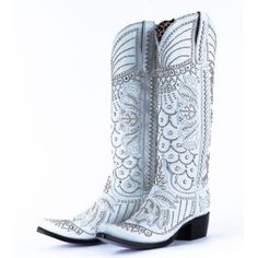 """The perfect partnership of talent and craftsmanship! The stunning Victoria Pearl White Swarovski Crystal boots are designed by Bob Kipperman/Kippys and manufactured by Lane! These boots are an eye catcher! Featuring riveted clear Swarovski crystals, silver studs, pearl overlays and pearl finished embellishments! These boots are simply jaw dropping! Words cannot describe the workmanship and attention to detail! The shaft measures approx. 16"""" tall with a circumference of 16"""". The heel is a…"""