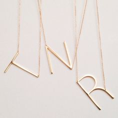2015 Gift Guide: Her \\\ Large Initial Gold Necklace by Gigglosophy \\\ $34 A simple, minimalist look featuring the letter of your choice hanging from a delicate gold chain.