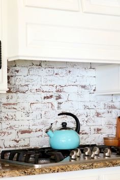 Real bricks painted and distressed behind cooktop