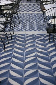 The blue tiled floor of the restaurant Maritim Barcleona features a mix of patterns; Granada tile in Los Angeles offers a selection of graphic blue and white designs from their Echo Tile collection.