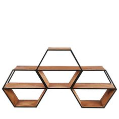 Ordinary shelving just doesn't cut it when it comes to style. This Hexagon Multi Shelf steps outside of the ordinary into the extraordinary for a unique spin on home storage. Grab a single shelf and stack to create your own design, or opt for the multi shelf for a pre-made update to your storage system. Hang on your wall to save space, or stack on the floor for a clever honeycomb effect.