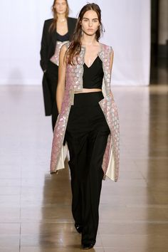 Maison Martin Margiela Spring 2014 Ready-to-Wear: Interesting cutaways along center front. Love contrast of pale pink with black