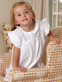 A little ruffle and embroidery detail makes this little girl's dress one of our favorites. Shop now at jacarandaliving.com