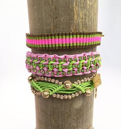"""A set of three friendship bracelets with handcrafted strands of lime green and pink with woven gold metal and crystals. adjustable 7"""" to 10"""" pull cord wider ban"""