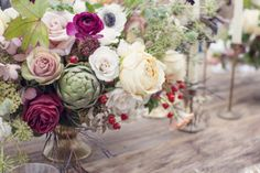 most favorite feel for centerpieces..The colors are off but I and drawn to the bohemian flow of this for the centerpieces...that and I like the artichokes, as I have seen them in some of the bouquets as well.