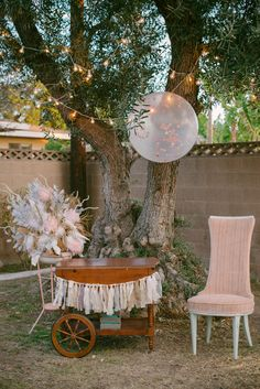 Super Sweet 16 Bash. Vintage Dessert Cart used for the Birthday Cake. Fabric Garland in Blush, Ivory and Gold tones. Blush and Mint Birthday Chair. Confetti Balloon overhead. Feather arrangement. Photo by Krista Mason Photography.
