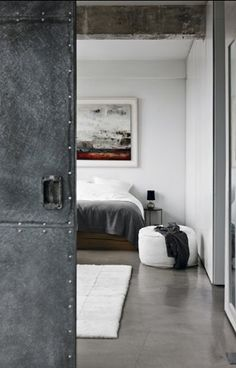 love how this metal door looks so soft in front of the bedding.. go gray!