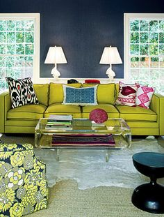 Barrie Benson works with acid green and festive pillows in a LR