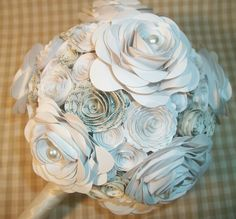 I'm kind of loving the idea of paper wedding flowers.