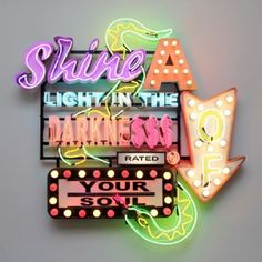'Shine a light in the darkness of your soul' Neon by artist Chris Bracey