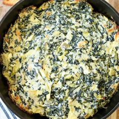 If you're looking for a crowd-pleasingappetizer that is sure to be a hit (and is super easy), this hot, cheesy Baked Spinach Artichoke Dip Recipe is it!Serve it in a bread bowl or with tortilla chips, either way, this is going to be your new favorite go-to appetizer!