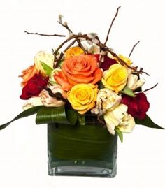 Roses, parrot tulips and pussy willow practically scream spring in this smooth and modern pave arrangement. Perfect for someone who loves the classic idea of roses with an updated look! $74.99