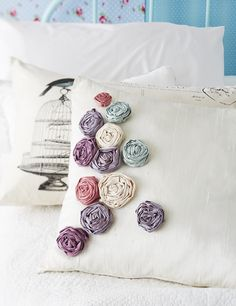 Decorate a scatter cushion with fabric roses