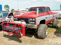 Lifted red GMC Sierra all set up -_z+mud_racing_in_florida+custom_gmc_truck