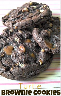 Calling all chocolate lovers... These Turtle Brownie Cookies will cure any chocolate craving!  They are insanely delicious with a hint of salty with the sw