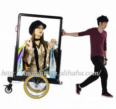 This is a Dual-use Bicycle Mobile Billboard Trailer. Can be used alone as towed, can also be connected to the bike.   Model:  JNDX-8-S  No Bike   INTERNAL LED ILLUMINATED BACKLIGHTING    External Size(L*W*H):  892*135*1305(mm)   Screen Size (L*W*H):   780*1193(mm)   Posters:  02   Battery Life: Up To 8 Hours   Color: Black