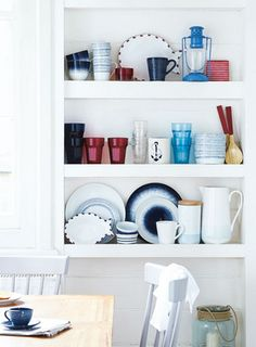 Don't hide away your crockery: show it off. Mix colours and shapes to create a display that's practical and pretty. Perfect for creating a coastal feel in your kitchen.