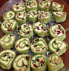Chicken Cranberry Pinwheels:  Add dried cranberries and pecans or walnuts to your favorite chicken salad recipe.  Roll up in spinach tortillas.  Wrap tightly in plastic wrap and chill for at least one hour.  Slice and serve.  Pretty and yummy!
