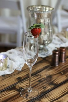 Strawberry on the Rim of a Champagne Glass adds a lovely pop of color and it's great with champagne for the toast!