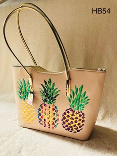 "Beige tote with pineapples; zipper closure • Dimensions: 17"" (w) x 11.25"" (h) x 4.5"" (d) • Handle drop: 10.5"" • Item # HB54"