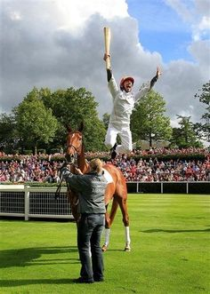 Here's Jockey Frankie Dettori leaping from ex-racehorse Monsignor, after carrying the Olympic Flame around the parade ring at Ascot. What we'd like is a funny caption for this picture. Answers below, best will win a Free Racing Tips mug. My Horse, Horse Riding, Horse Racing Uk, Olympic Flame, Sport Of Kings, Dressage Horses, Racehorse, Sports Photos, Champs