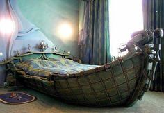 Bedroom With Unique Bed _ Interesting about it is the fascinating bed made in the form of a ship from the 18th century. Hanging from the ceiling we see curtains painted in green and purple and on the floor we notice a purple rug as well. Also we have to point out the amazingly decorated back wall which has a beautiful sunset depicted on it in green  purple to match the colors of the other furniture in the room.
