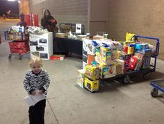Manning our donation site at Sam's Club for the byGrace Ministries Hurricane Sandy Relief Effort~ with my little muffin helper Selah!
