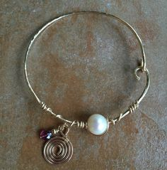 Gorgeous 14 Kt gold-filled bracelet with Pearl and Tourmaline, now for sale at Northwood Gallery, Midland, MI.