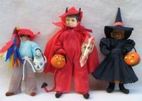 more spun cotton dolls with paper faces and clothing