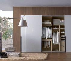 Sliding white doors | fitted wardrobe | set within wood