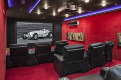 The entertainment hall on the lower ground floor includes a large cinema room, bar and fully equipped gymnasium: Even the walls of the cinema room are decked out in plush red carpet