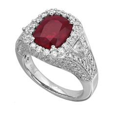RR25249: A 3.32ct ruby ring made in platinum with 1.69ct round diamonds and 0.23ct trillion cut diamonds | www.goldcasters.com