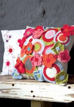 pillow with crochet flowers....my niece would love this