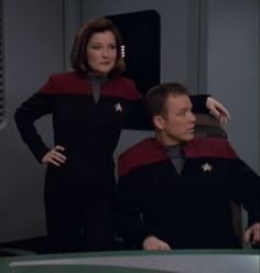 """Star Trek: Voyager Screencap--""""Dark Frontier""""...And why shouldn't Captain Janeway stand this way in an officers' meeting (part 2)?"""