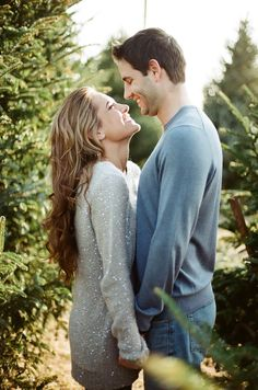 Engagement Photos Photography: Feather & Twine Photography - featherandtwinephotography.com Read More: http://www.stylemepretty.com/2013/12/24/christmas-tree-farm-engagement-session/