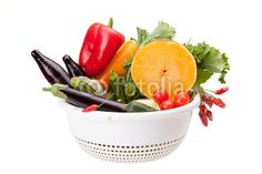 Colander With Vegetables On White