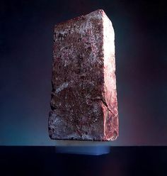 """Yup, that's a brick.  It's sitting on Aerogel, ""frozen smoke,"" the world's lowest-density solid. The stuff is 99.8% air but can support 2,000 times its own weight, and it holds 15 entries in the Guinness Book of Records.  Most amazingly, it was first created in 1931 by Dr. Samuel Kistler."""