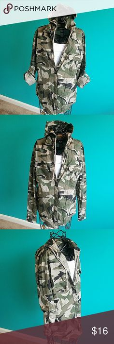 Cotton Express fatigue camo long sleeve hoodie NWOT. Great for the fall weather as it has a hoodie . Sleeves could be rolled up as seen in photo. Great with leggings. Two front button pockets.  Feel free to ask any questions prior to purchase. ✌💚😊 cotton Express Tops Button Down Shirts