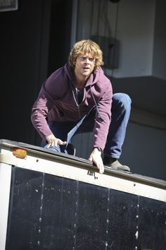 """Spiral"""" - NCIS: Los Angeles S6 E12 Pictured: Eric Christian Olsen (LAPD Liaison Marty Deeks). While Callen is undercover in the mail room of an office building to investigate an arms dealer, it is over taken by terrorists and Callen becomes a hostage. When the team arrives to help, they discover the entire building is wired with explosives, on NCIS: LOS ANGELES,"""
