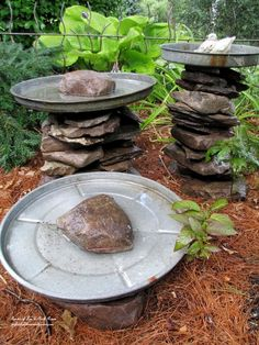 DIY - Stacked Stone Bird Baths using rocks and old trash can lids.