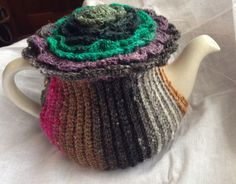 The Flower Top Tea Cozy - one skein of Noro Silk Garden Sock and a vintage button