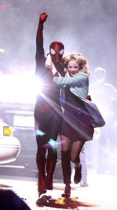 Andrew Garfield and Emma Stone pretended to swing on the set of 'The Amazing Spider-Man 2' in Chinatown.