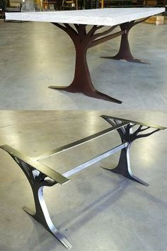 What an interesting custom table leg base.  Made from metal.  Love the tree.  Chair selection for the table should be careful to not block the design.  Wouldn't a reclaimed wood top be cool with it?