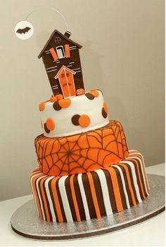 I like the black white and orange stripe idea for a halloween cake.  Top with pumpkins made of modeling chocolate.