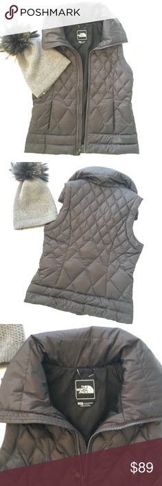 Northface Quilted Vest 600 Goose down Fill EUC.  Worn twice. Great price for a like new, stylish Northface vest. - Hits at hip - Satin, dark grey finish - Zipper collar hides an optional, water-resistant, hood - Fitted for a flattering fit - Secure side-zip, hand pockets - Full Zip Front The North Face Jackets & Coats Vests