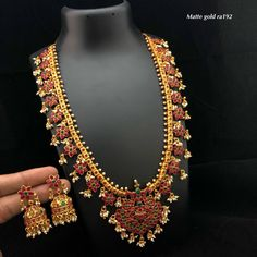 Beautiful one gram gold long haaram with guttapusalu hangigns. Long haaram with lotus flower hangings. Long haaram studded with pink and green color stones. Gold Jewellery Online Shopping, 1 Gram Gold Jewellery, Ruby Jewelry, Gold Jewellery Design, Jewels Online, Jewelry Art, Italian Gold Jewelry, Clean Gold Jewelry, Indian Jewelry