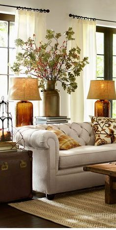 Love: the couch, the lamps, the understated metal curtain rod, etc.