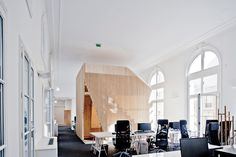 Ekimetrics HQ by Estelle Vincent Architecture within a classic Haussmann building on the Champs-Élysées in Paris.
