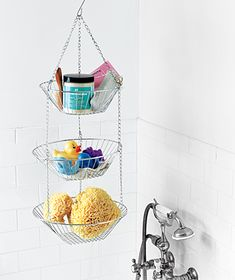 When you don't have ledges in your tub to stow bath products, hang a multilevel fruit basket for additional space.
